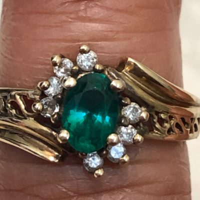 10kt Gold ring with an Emerald and Diamonds
